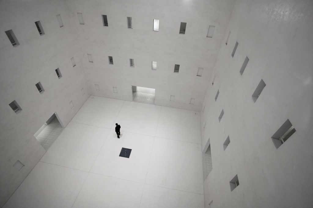Man standing in desolate room