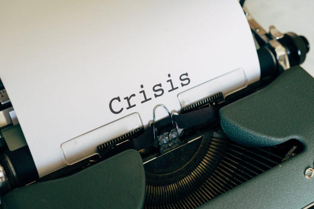 typewriter with crisis written